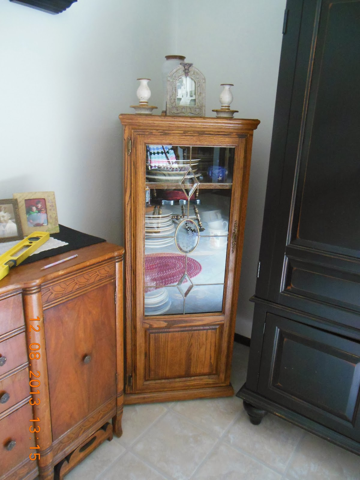 Re purpose an Entertainment Center into a Dish Storage Cupboard