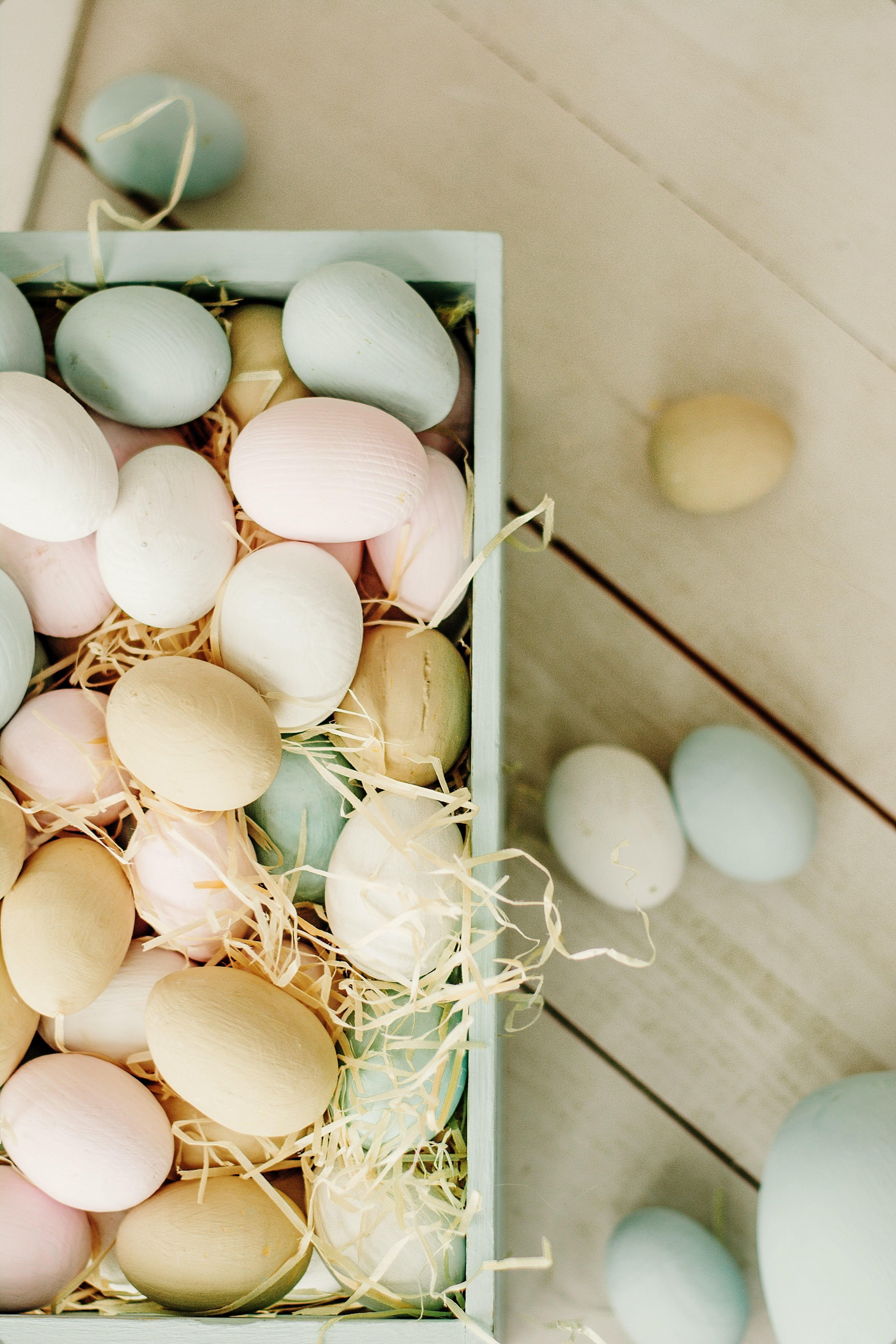 White and Brown Eggs on White Wooden Tray | Photo by Євгенія Височина via Unsplash