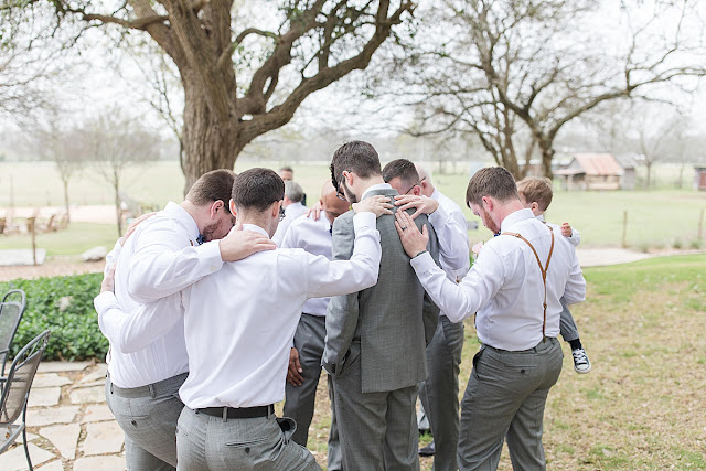 Gruene Estate New Braunfels Texas wedding venue, groomsman photos, praying before wedding photo