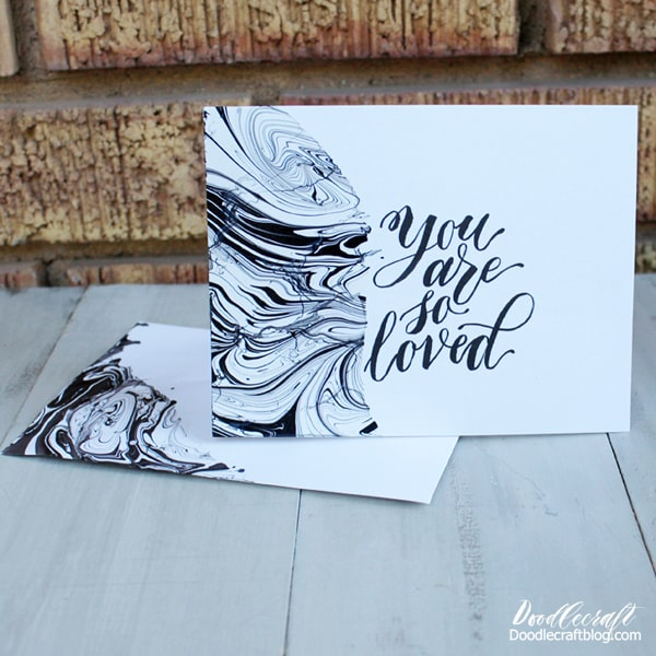Black and white Easy Marble marbling on white stationery cards and envelopes with hand lettering.