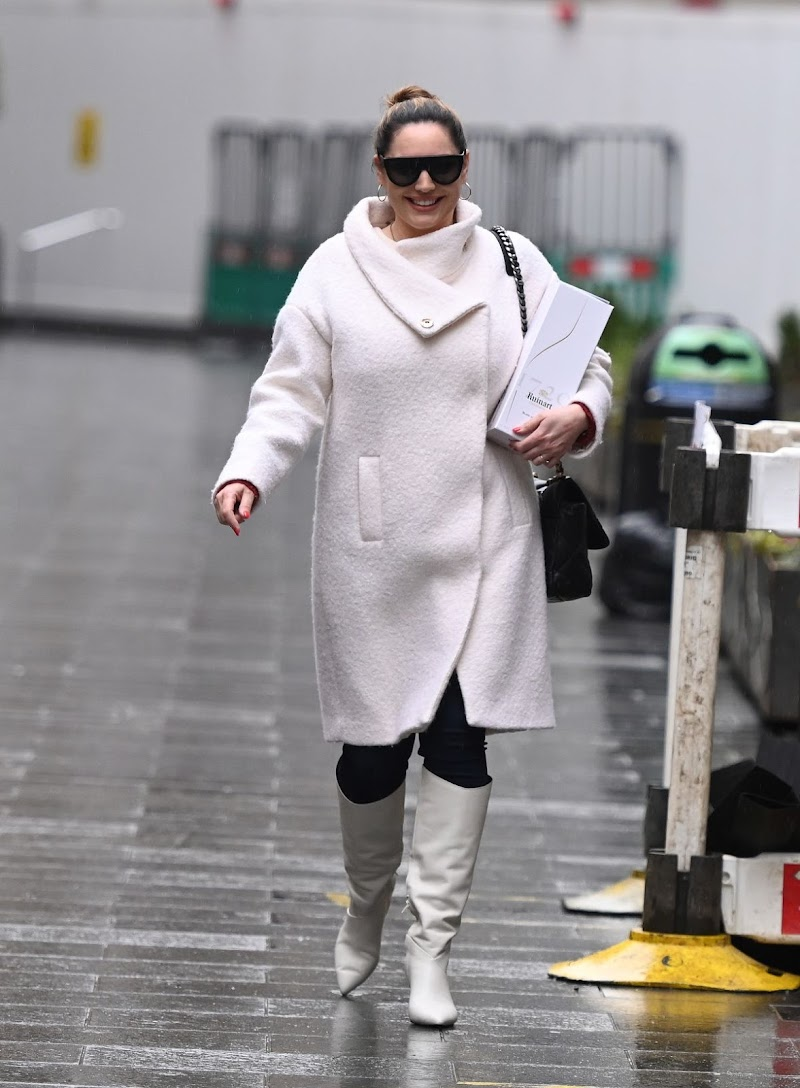 Kelly Brook Clicked in a White Coat and Boots at Global Radio in London 23 Dec-2020