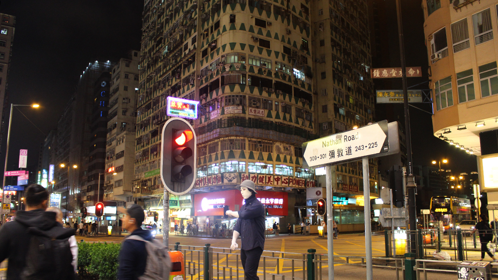 Here's a photo of a man in Hong Kong wearing a mask.