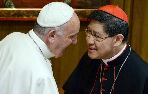 Pope Francis talks to Cardinal Luis Tagle.