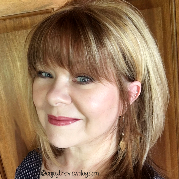 Blonde woman with long layered hair wearing Pink Champagne Lipsense Lip Color by Senegence!