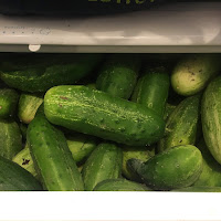 Photo of pickling cukes in a refrigerator crisper drawer. https://trimazing.com/