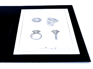 岡田訓明が描いたデザイン画の上にリスタイル(リメイク)された指輪を乗せて撮った写真
