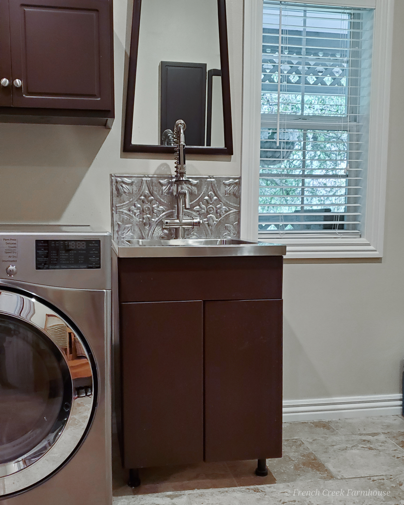Before: Our utility sink cabinet in dark brown paint