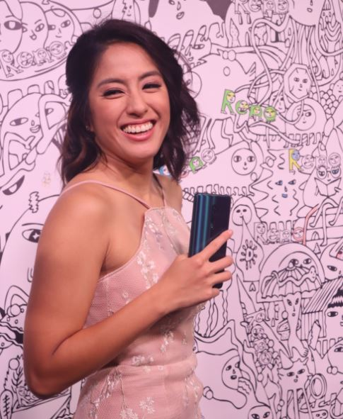 TV host Gretchen Ho happy to pose with her Reno 10x Zoom
