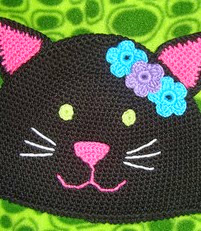 http://www.ravelry.com/patterns/library/kc-kitty-cat-hat-pattern-us-terms