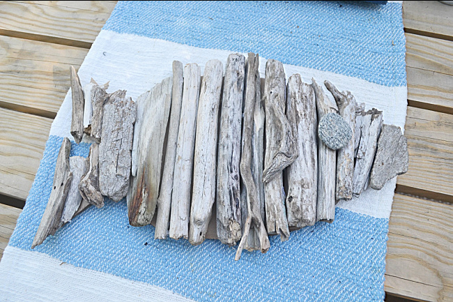 driftwood fish on a blue and white table runner