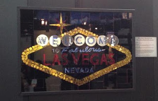 Laticrete's Vegas sign using SpectraLock Grout Dazzle and mosaic tile