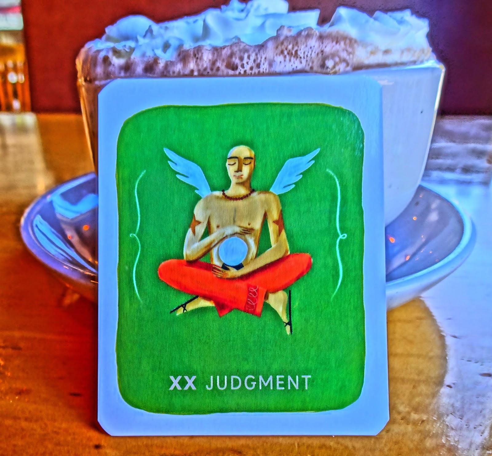 XX Judgement leaning against mug of hot chocolate