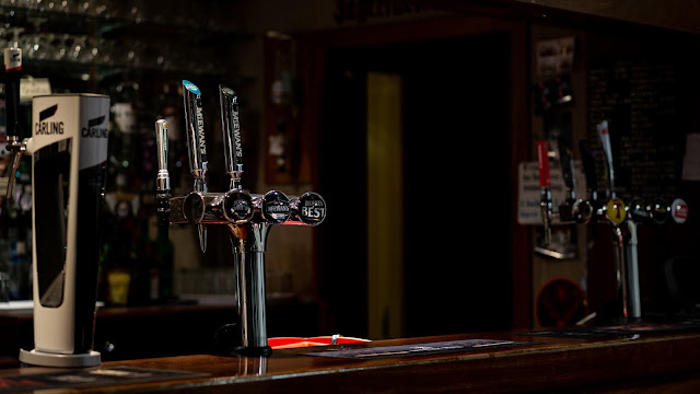 Close up photo of a bar with a beer tap - Photo by Jordanne lee creative