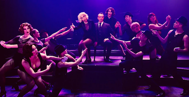 """We Both Reached For The Gun"" musical number Center Stage: Monique Hafeb Adams (as Roxie Hart), Keith Pinto (as Billy Flynn), Kyle Bielfield (as Mary Sunshine) Ensemble: Patrick Wayne, Jill Miller, Jacqueline Neeley, Zoey Lytle, Matthew Kropschot, Tony Wooldridge, Tracey Freeman-Shaw, Monica Moe, Vinh G. Nguyen, Nick Rodrigues. Photo By Dave Lepori"