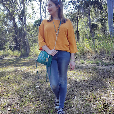 awayfromblue Instagram | Kmart short sleeve textured dolman top in marigold with skinny jeans and converse for spring