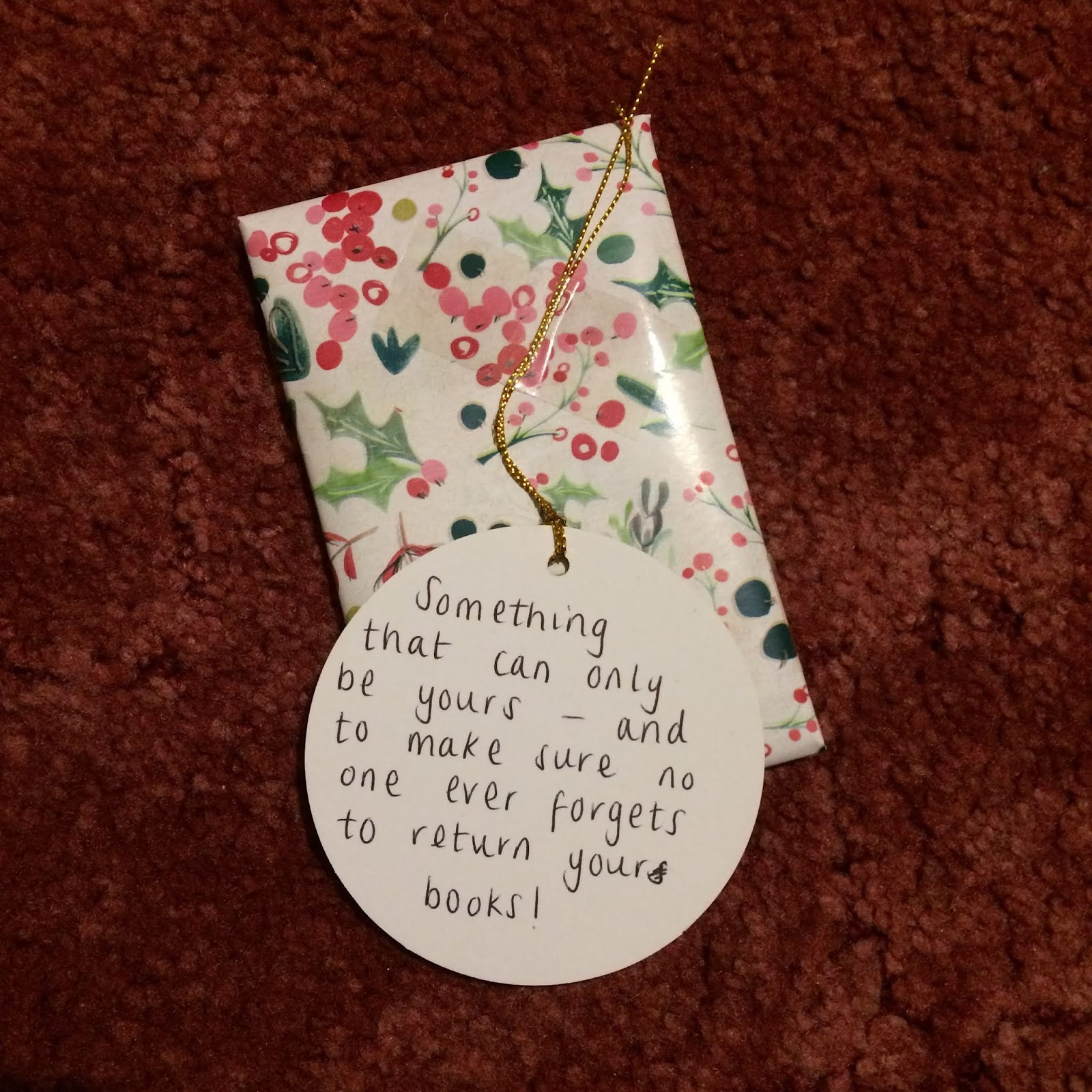 Wrapped present with tag reading, Something that can only be yours - and to make sure no-one ever forgets to return your books!