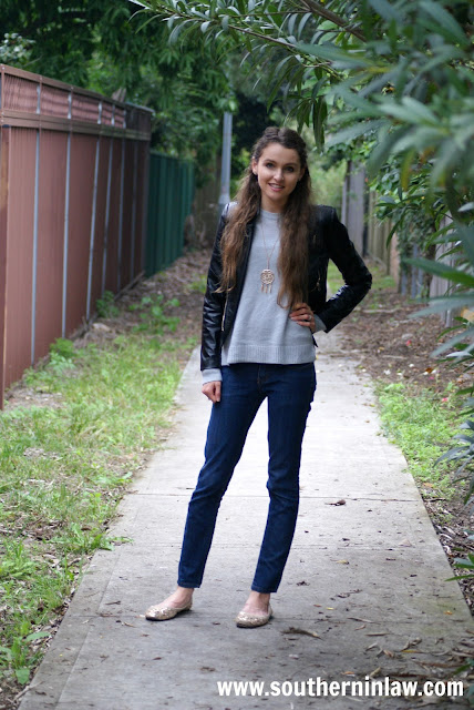 Real Girl Fashion - Fall Outfit Inspiration - Leather Jacket, Gray Sweater, Statement Necklace and Jeans with Sparkly Gold Flats