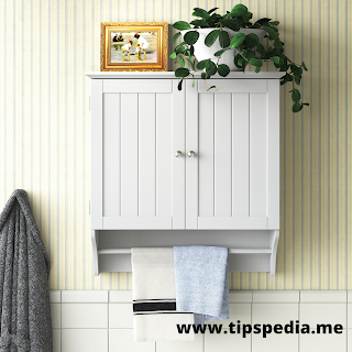 white bathroom wall cabinet with towel bar
