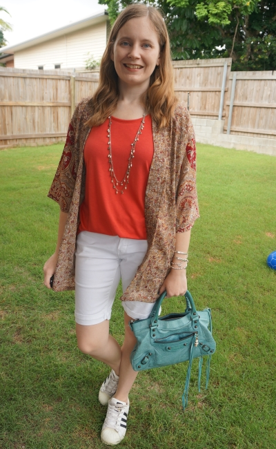 gold and burgundy silk kimono with red tee and white Bermuda denim shorts turquoise Balenciaga bag | away from blue