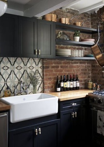 The combination with white farmhouse sinks, neutral subway tiles, exposed brick walls and reclaimed wood.