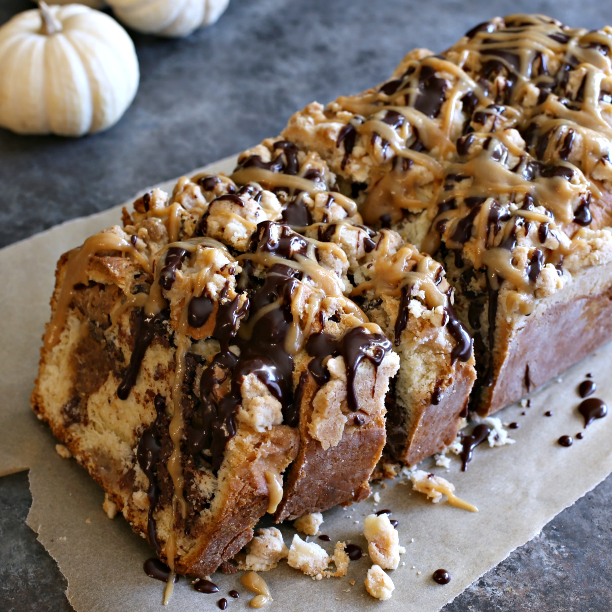 Recipe for a yeast cake with swirls of chocolate, peanut butter and a crumb topping.