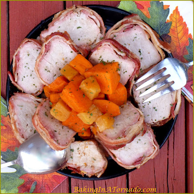 Maple Pineapple Pork Tenderloin, pork tenderloin wrapped in bacon with sweet potatoes and pineapple slow cooked in an easy sauce. | Recipe developed by www.BakingInATornado.com | #recipe #CrockPot #dinner