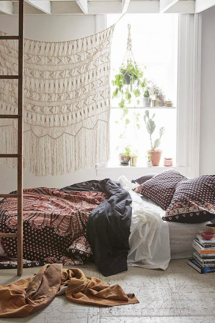 bohemian bedroom with a large macrame