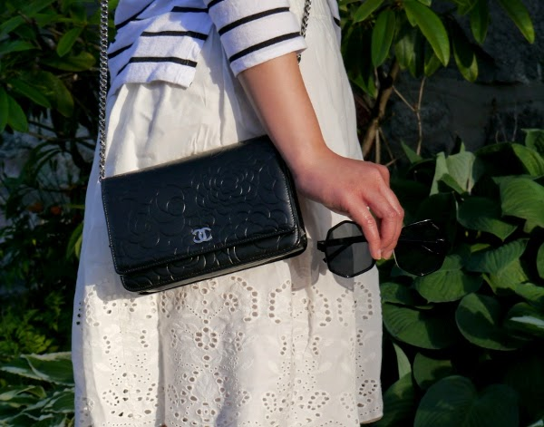 Chanel WOC, white eyelet skirt, and KOMONO shades