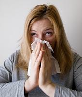 woman sneexzing