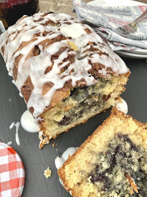 Moist loaf cake baked with creamed sweetcorn and dollops of blueberry conserve topped with lime icing
