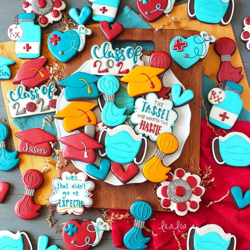 Brightly colored graduation chocolate decorated sugar cookies