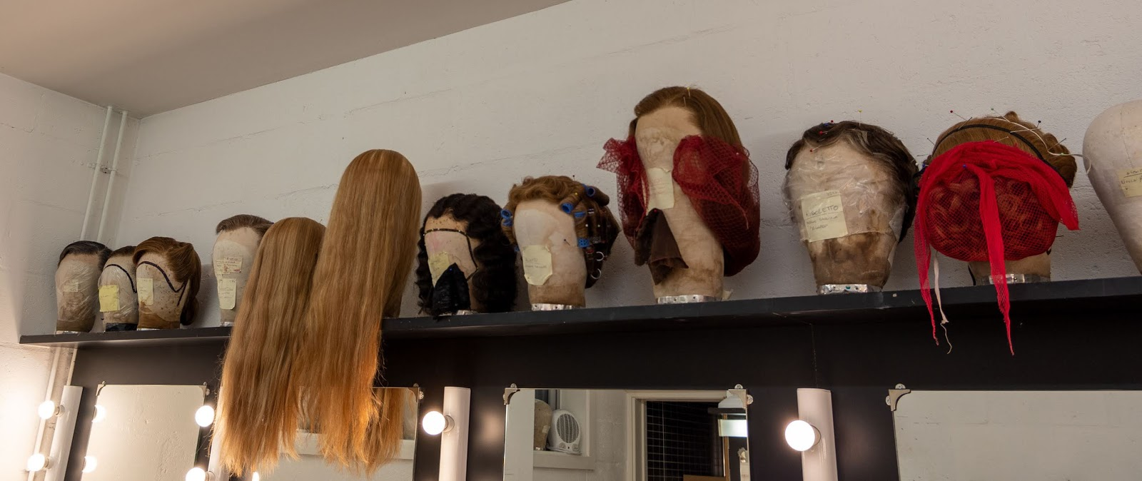 Glyndebourne production wigs in one of the Marlowe Theatre dressing rooms