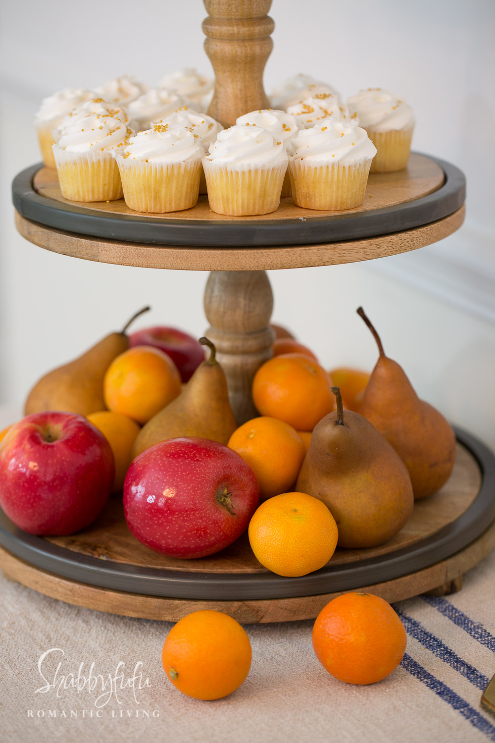 buffet stand with fruit and cupcakes