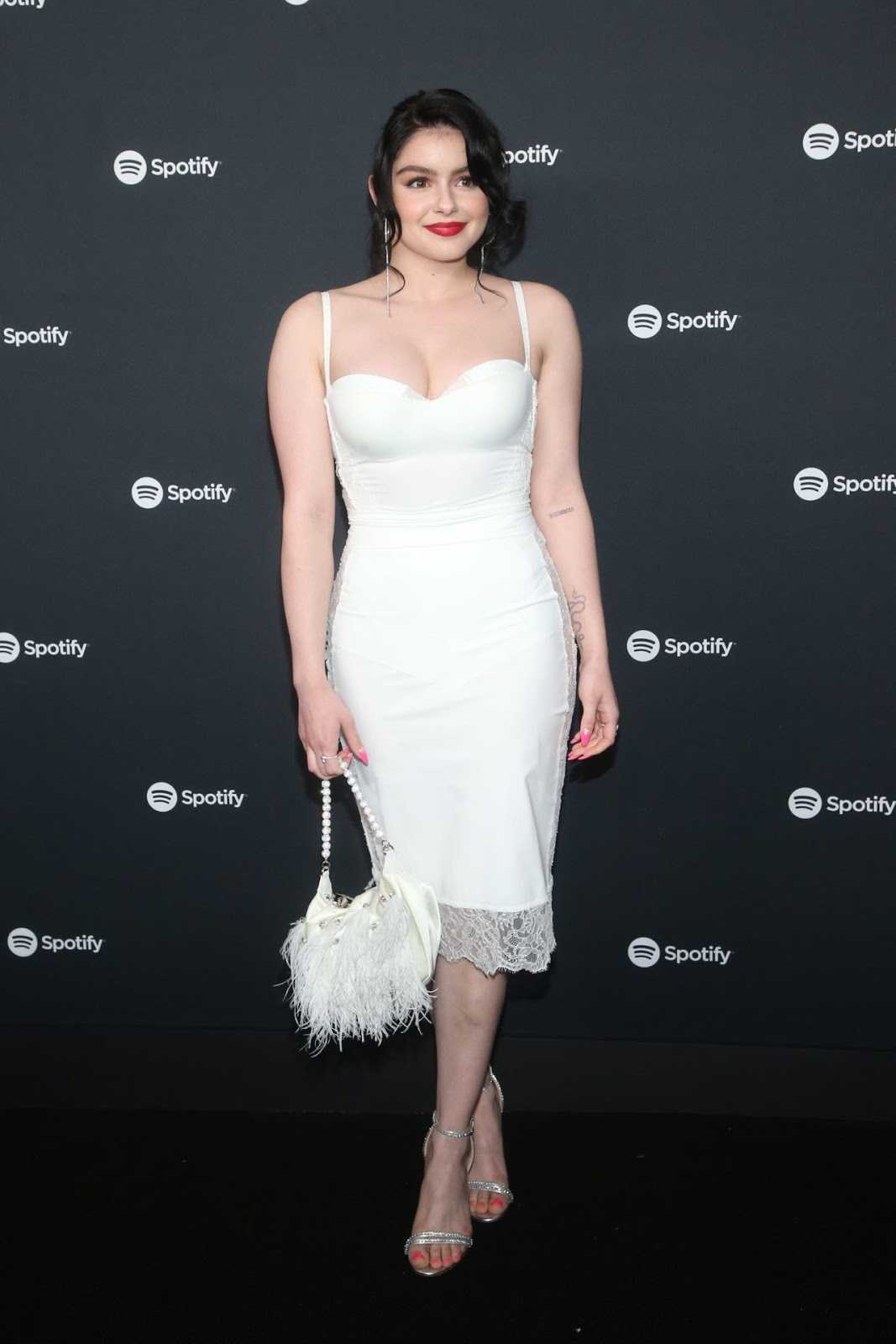 Ariel Winter, 21, turns heads in low-cut white dress at Spotify party in LA as her sitcom Modern Family ends after 11 seasons