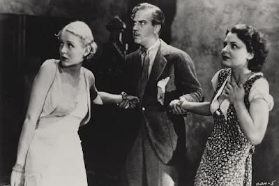 """Movie scene in """"The Old Dark House"""" (1932) where Gloria Stuart and Lilian Bond are being comforted by Melvyn Douglas"""