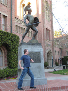 Noah copying the pose of the Trojan Statue at USC
