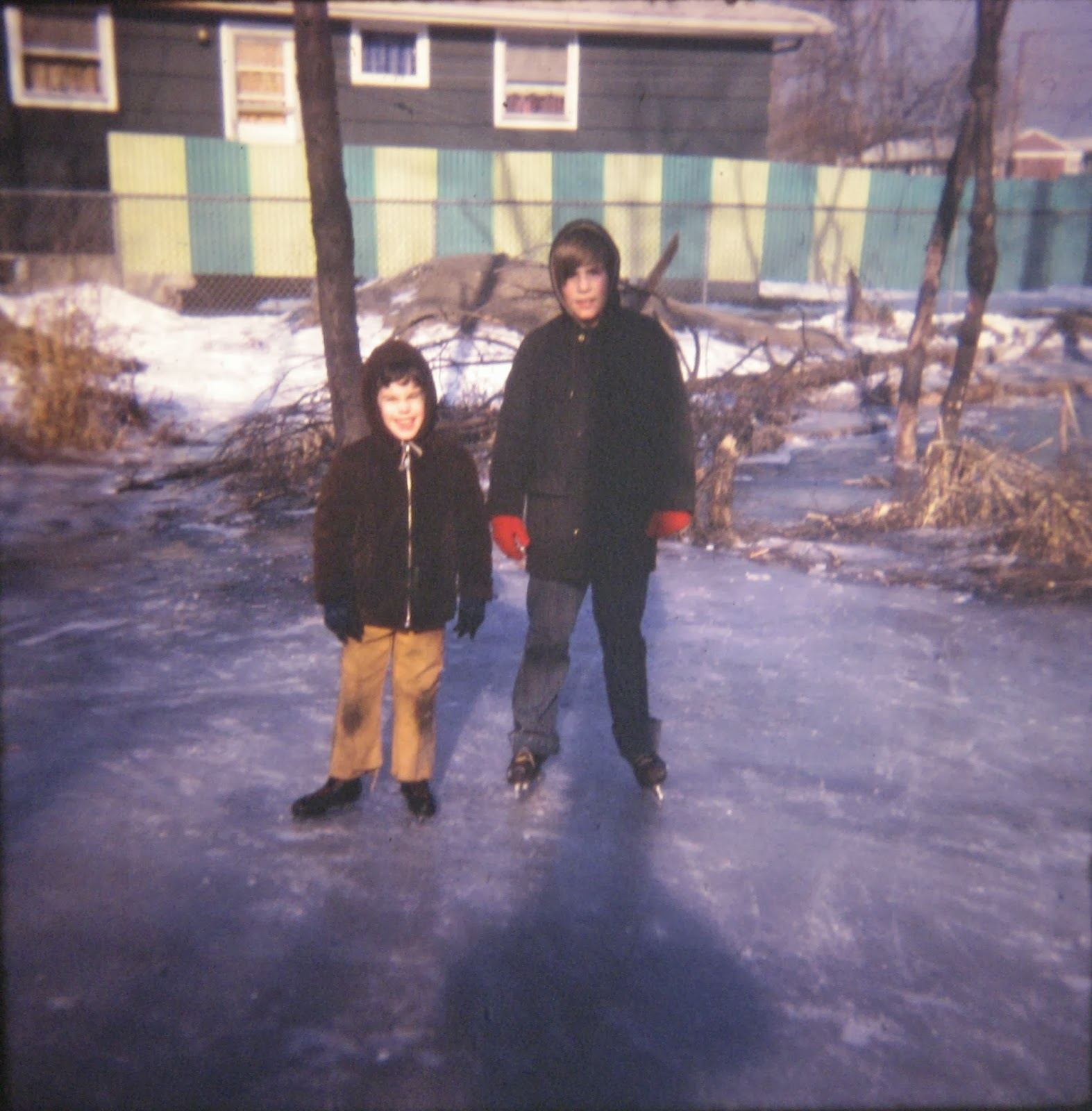 Tommy & Michael Mondello ice-skating at the swamp up the block Feb 1971