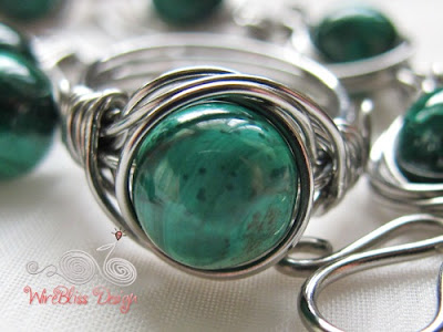 Twice Around the World (TAW) wire wrapped ring with Malachite