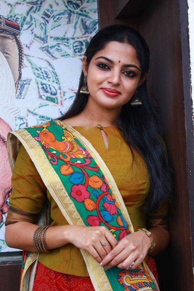 Indian Actress Nikhila Vimal Hot Stills In Yellow Dress