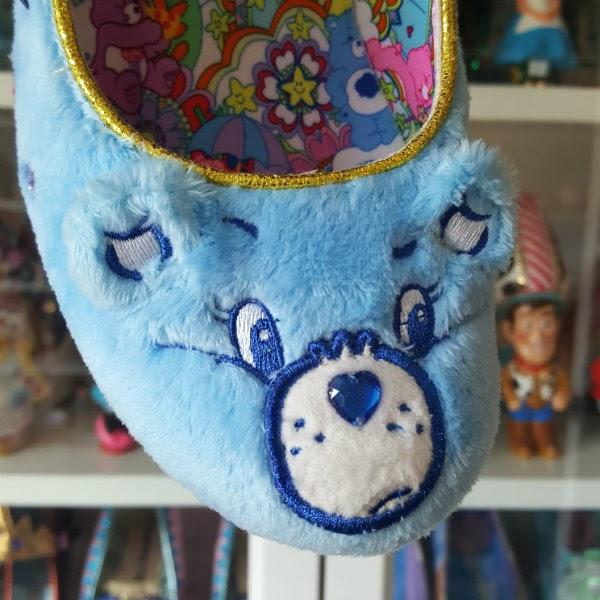 fluffy blue toe of shoe in style of Grumpy Bear Care Bear