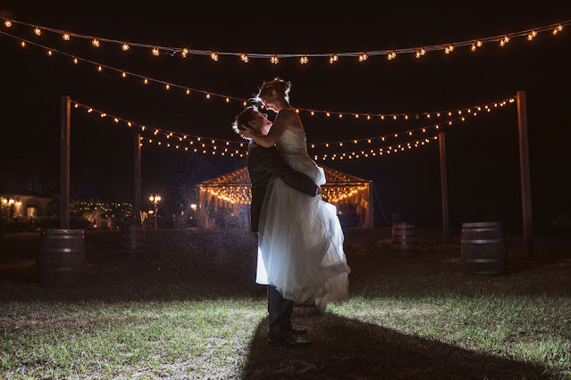 Bride and groom outdoors photo