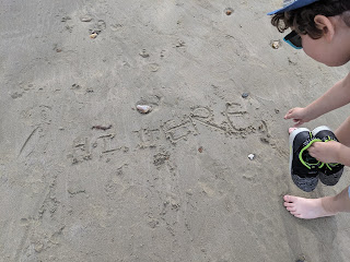Dan Jon using punctuation on the beach