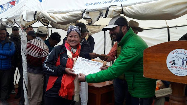 Roshni Rai Receiving certificate from Indian Army Colonel, who lead the Indian Army Expedition to Everest 2016..jpg