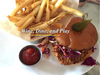 The crucnhy chicken sandwich with french fries at the Sea Salt restaurant in St. Petersburg, Florida