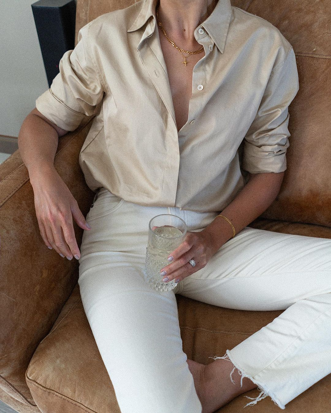 Easy Chic Summer Outfit Idea with Beige Button-Down Shirt and White Jeans from Emma Hill on Instagram
