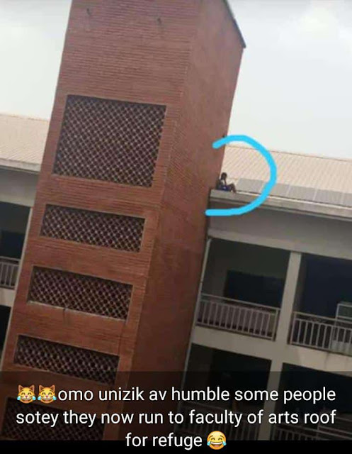 What Is Happening? Student Pictured On Top Roof Of UNIZIK Faculty Building