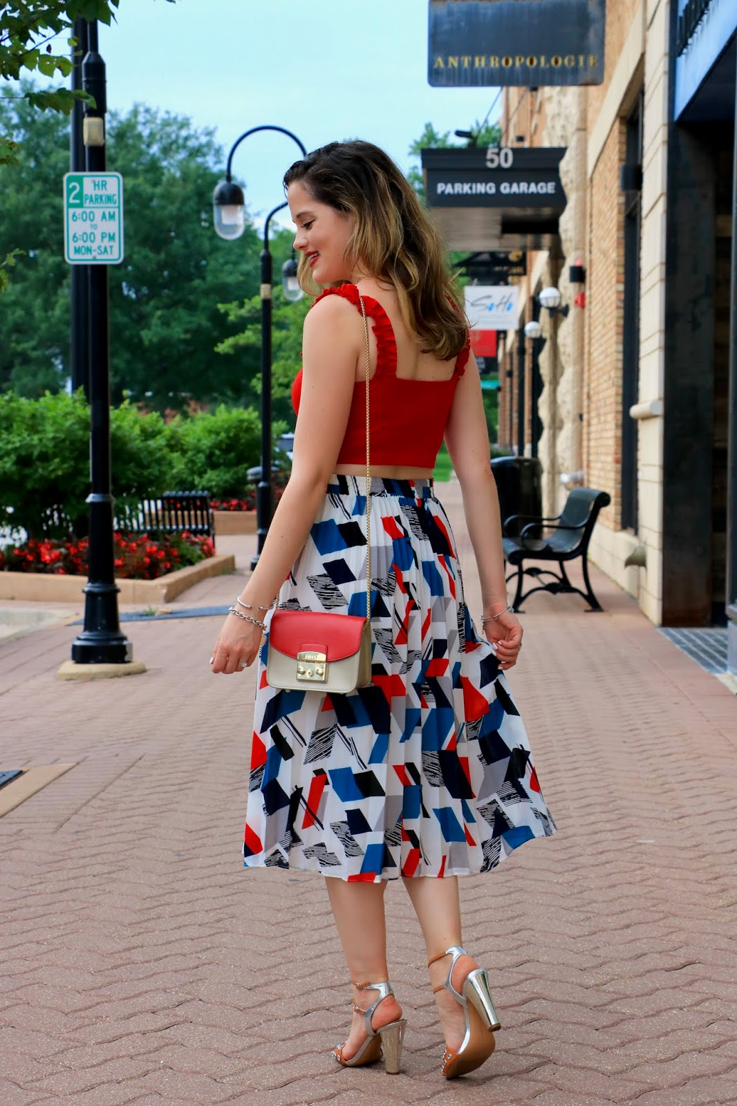 Nyc fashion blogger Kathleen Harper wearing a summer date night outfit of a skirt and crop top.