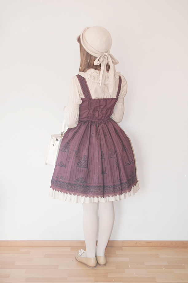 a finnish classic lolita facing backwards in innocent world's birdcage jsk