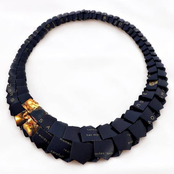 black and gold origami necklace made of catalogue paper