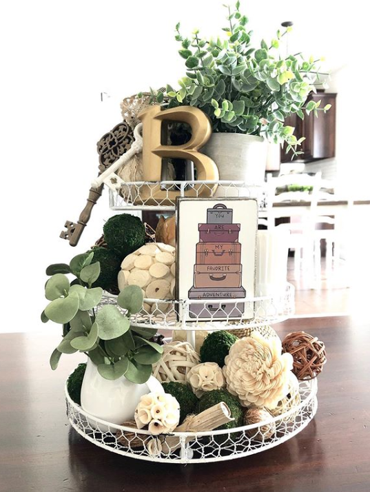 A three-tier wire tray with botanical decor